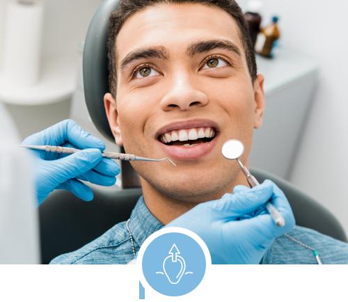 Man getting a dental exam in Largo, MD