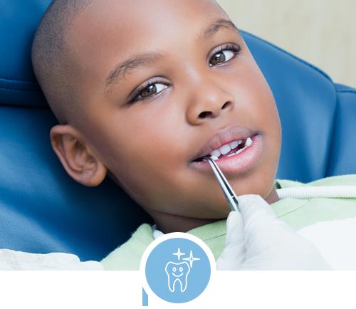 Black kid get a dental exam